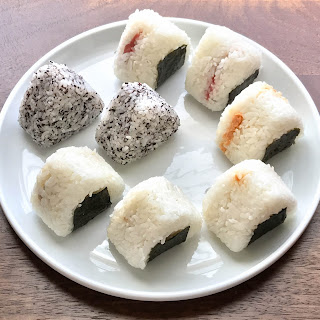 Omusubi (Japanese rice balls) with tuna, salted salmon, and umeboshi.