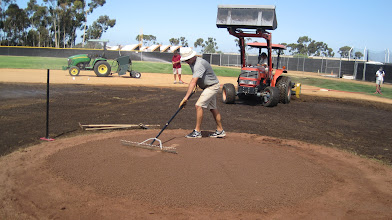 Photo: Moving around clay and shaping mound