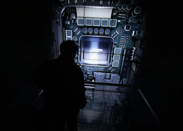 A man tours a showroom of Samsung Electronics in Seoul. Picture REUTERS