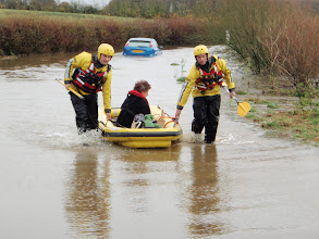 Photo: Handout photo issued by Dorset Fire and Rescue Service of a motorist who was rescued by the service after becoming stuck in a flooded road at Longburton between Dorchester and Sherborne, Dorset.PRESS ASSOCIATION Photo. Photo date: Wednesday November 21, 2012. See PA story WEATHER Floods. Photo credit should read: Dorset Fire and Rescue Service/PA Wire NOTE TO EDITORS: This handout photo may only be used in for editorial reporting purposes for the contemporaneous illustration of events, things or the people in the image or facts mentioned in the caption. Reuse of the picture may require further permission from the copyright holder.