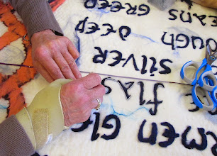 Photo: needlefelting through plastic stencils to make the lettering
