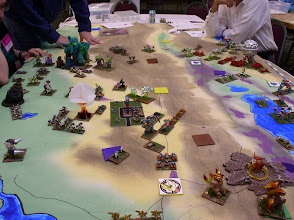 Photo: Almost the full battfield, as the Martians assualt the GUARD Stronghold.  The Martians have maintained control of two Power Centers for several bounds and benefited from the power surge that they provide.