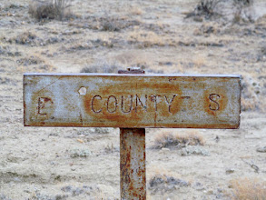 Photo: Sign at the Emery-Sevier county line