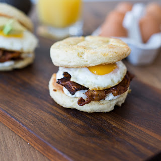 Cava Breakfast Sandwich: Crazy Feta Biscuits + Harissa Bacon + Fried Egg + Tzatziki