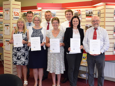 Estate agent staff celebrate professional qualifications
