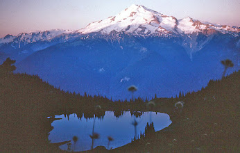 Photo: 52. Dawn over Image Lake and Glacier Peak. The Suiattle River valley separates Miner's Ridge from Glacier Peak; the bottom of the valley is about 2,000 feet in elevation, leaving 8,000 feet between it and the top of Glacier Peak.