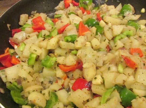 Stir potato mixture to blend together. Continue to cook over medium high heat, till...