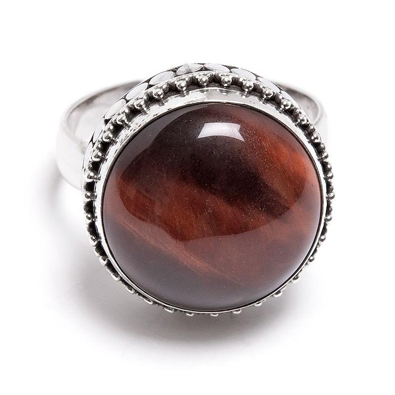 Oxöga, ring i silver med filigrankant
