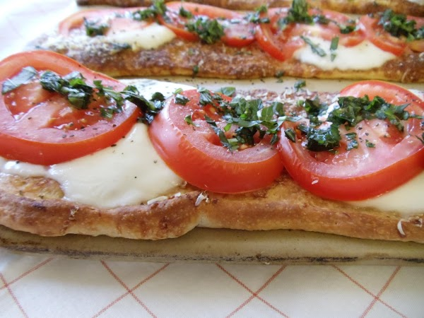 Remove baking stone from oven. To serve, brush basil mixture over pizzas using silicone...