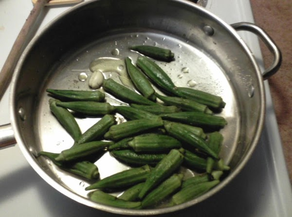 Add okra,1 tablespoon oil and 1/4 cup water, optional clove of garlic, salt and...