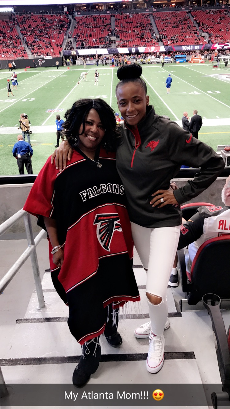 Linda Chatmon and Miko Grimes at the Falcons Game