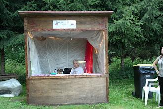 Photo: Sjaak van der Leden prepares a dia-presentation on laptop of his work