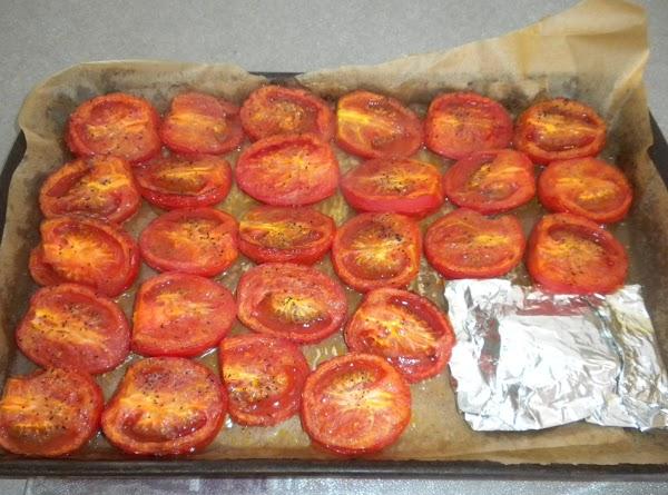 Preheat oven to 400 degrees.  Toss tomato halves and olive oil.  Arrange...
