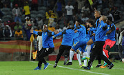 Pitso Mosimane and his team erupts in celebrations after winning the 2016 Caf Champions League trophy.
