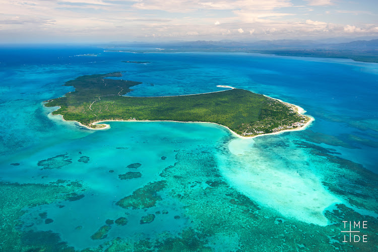 The turquoise waters off Nosy Be, Madagascar. are home to pristine coral reefs and exotic marine life.