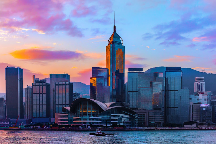 The sun rises over Victoria Harbour in Hong Kong. Picture: 123RF/CHANCHAI DUANGDOOSAN