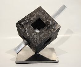 Photo: PIERCED FENESTRATION -11H X 17W X 14D Lost Foam Iron Casting , Polished Aluminum & Polished Mild Steel, Front View
