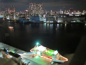 Photo: Night view from our hotel room (we did not take the $100+/head dinner cruise on the boat docked here)