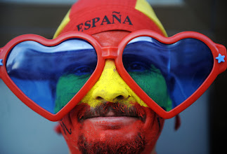 Photo: A supporter of the Spanish team waits for the start of the World Cup final football match Spain against Netherlands on July 11, 2010, in Camas, Sevilla. AFP PHOTO / CRISTINA QUICLER (Photo credit should read CRISTINA QUICLER/AFP/Getty Images)