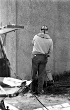 Photo: Removing graffiti from Music and Speech building