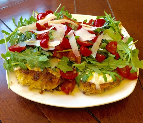Plate the chicken. Top each piece with some arugula. Place tomato mixture on top...