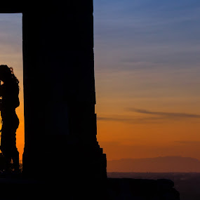 Couple in the top hill gate by Frederiko Ferry - People Couples ( holiday, adventure, vacation, top hill, sunset, couple, man and women, gates,  )