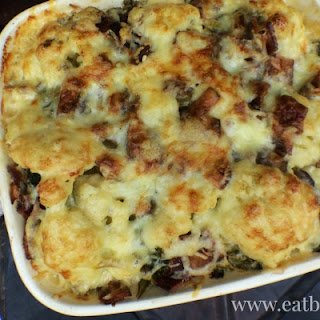 Cauliflower Au Gratin Casserole with Bacon and Mustard Greens.