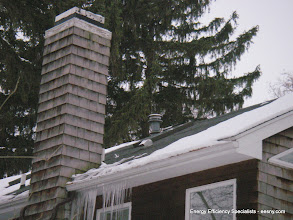 Photo: Very distinct snow melt/icicle formation on this roof.