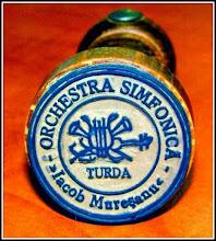 """Photo: """"Ştampila rotundă din lemn ce a aparţinut compozitorului Iuliu Mureşianu (1900-1956).  În zona de aplicare a ştampilei sunt excizate cuvintele """"ORCHESTRA SIMFONICĂ - Iacob Mureşanu"""".  În zona centrală a ştampilei există un motiv decorativ reprezentând o liră, două trompete încrucişate şi o vioară  sub care scrie TURDA.  Pe mânerul ştampilei este aplicată o ţintă pentru a indica poziţia de aplicare corectă a ştampilei în pagină."""" sursa - Facebook, Remus Chiorean https://www.facebook.com/photo.php?fbid=1469942996652516&set=a.1461038877542928.1073741826.100009104908756&type=1&theater"""