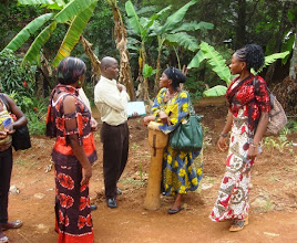 Photo: Pastor Eugene and his wife Mirabell, sharing Christ with residence in the village of Akum.