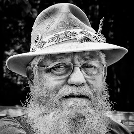 Archer by Jebark Fineartphotography - People Portraits of Men ( monochrome, glasses, black and white, beard, natural, rural, portrait, man, hat )