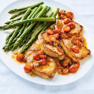 Seared Pork Chops With Wilted Tomatoes.