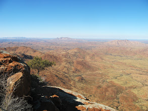 Photo: From the summit of Mt Zeil, the steep southern cliff face is below, Mt Sonder in the centre distance, Mt Razorback right distance. The vast valley from Redbank Gorge (the gorge is between the range that goes from Mt Sonder to Mt Razorback) is the route we took in 2011 as a three day summit attempt. We got within maybe 1.5km of the summit, it was hard going, and water was a challenge. Today's summit along the western spur had taken 4 hours.