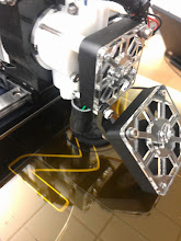 Photo: Printing with a 10% hexagonal infill. The yellow tint to the bed is because we decided to try a layer of kapton.