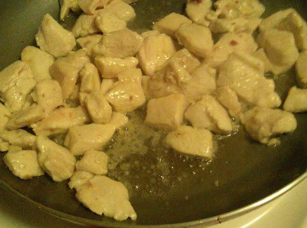In the same pan, add the bacon grease, garlic, diced onion, diced pepper, chicken...
