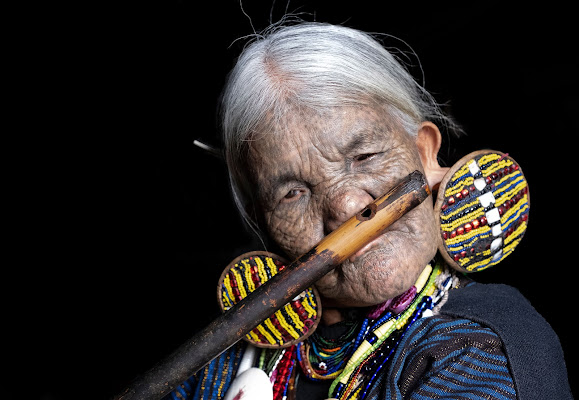 Chin woman with face tattoos, plays traditional nose flute di tonino_de_rubeis