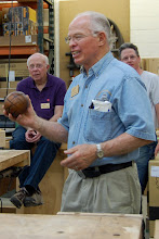 Photo: Phil Brown talks about a hollow sphere that he made several years ago.