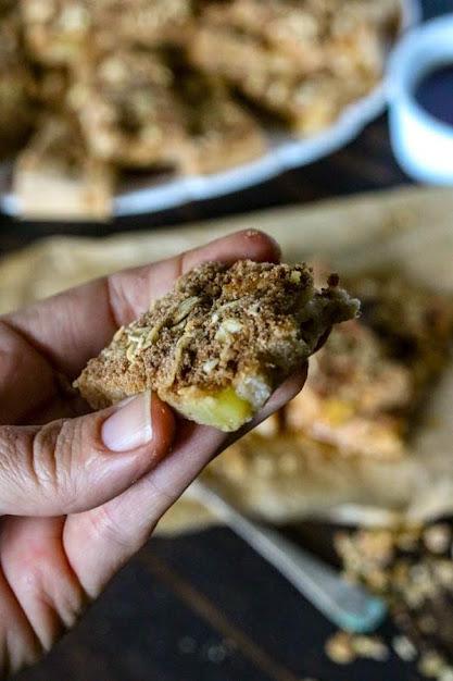 a hand holding an apple pie pancake bar