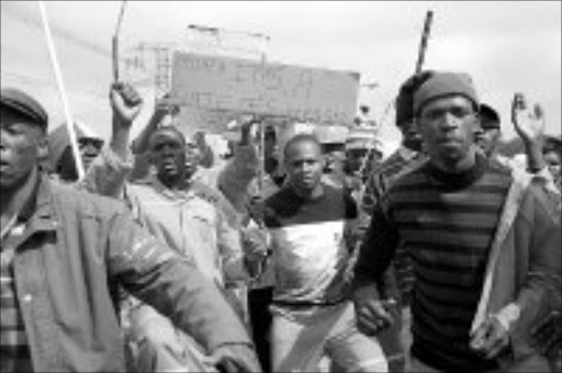 ANGERED: Gautrain workers during a protest in Sandton yesterday. Pic. Thobeka Ndabula. 25/09/07. © Sowetan.