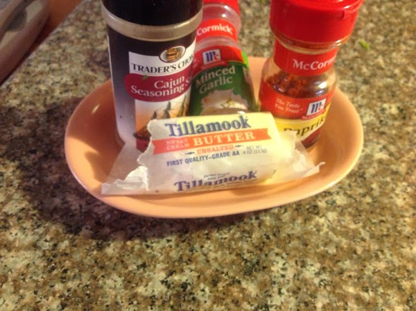 Add cooked rice a spoonful, lift & lightly stir.Add Cajon seasoning, only a heavy...