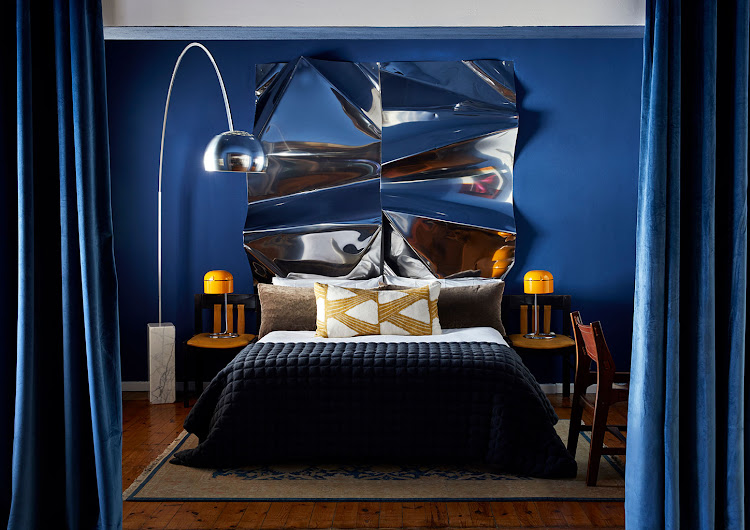 The master bedroom includes a sculpture by Kane Hart functioning as a headboard.