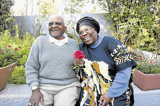 GOLDEN: The day before their 50th wedding anniversary, Archbishop Emeritus Desmond Tutu with his wife Leah, relax in the garden at their home in Soweto