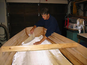 "Photo: Fitting 6oz. fiberglass cloth to inside bottom. It gets ""wet-out"" with unthickened epoxy."