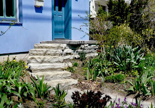 Photo: Natural stone steps and a mega-flag cap welcome visitors to this beautiful home and garden.