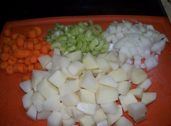 Chop up  the carrots , celery , onion and potatoes.