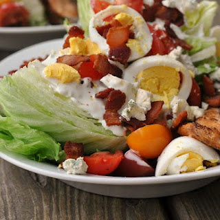 Loaded Wedge Salad with Grilled Salmon.