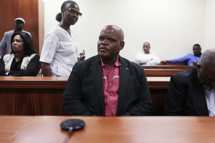 Former acting police commissioner Khomotso Phahlane (left) appears at the Specialised commercial crimes court with his co-accused major general Ravichandran Pillay, in Johannesburg, where they are facing charges of fraud and corruption relating to tender irregularities on March 1 2019.