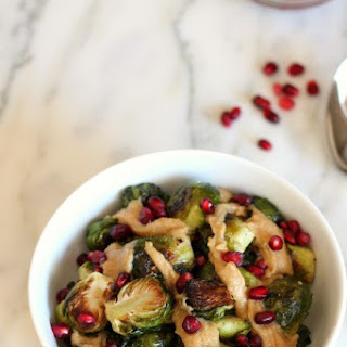 Roasted Brussels with Pomegranates and Maple Tahini