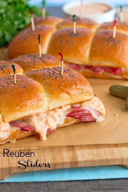 """Reuben Sliders""""These mini Reubens are overstuffed with corned beef, sauerkraut and gooey..."""