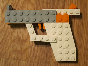 Photo: Gun. Somehow this felt wrong to make out of Lego. I feel like Lego is a mostly non-violent toy, despite some mini-figs having swords or whatnot.
